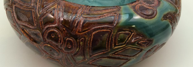Example 2B: you can see where the sparkly copper glaze wasnt covered by the green.