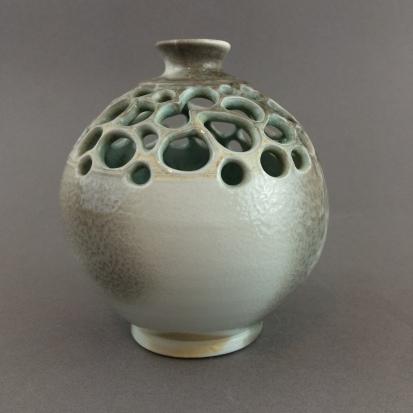 carved round vase 1